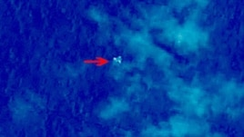 "Handout photo provided by China Center for Resources Satellite Data and Application shows satellite image, illustrating objects in a ""suspected crash sea area"" in the South China Sea on March 9, 2014."