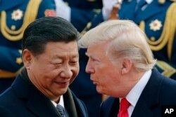 FILE - U.S. President Donald Trump, right, chats with Chinese President Xi Jinping in Beijing.