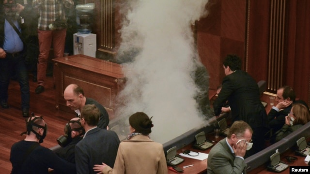 Tear gas is released during a session of parliament in Pristina, Kosovo, ahead of a vote on the selection of Hashim Thaci as president, Feb. 26, 2016.