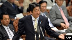 Japanese Prime Minister Shinzo Abe answers a question by an opposition lawmaker at the Upper House at the National Diet in Tokyo, April 23, 2013.