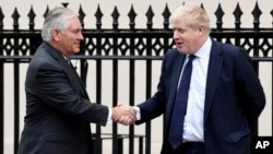 U.S. Secretary of State Rex Tillerson, left, is welcomed by Britain's Foreign Secretary Boris Johnson in London, Jan. 22, 2018.