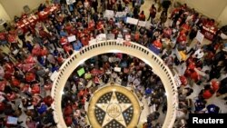 Teachers pack the state Capitol rotunda to capacity, on the second day of a teacher walkout, to demand higher pay and more funding for education, in Oklahoma City, Oklahoma, April 3, 2018.
