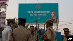An Indian Police officer briefs his colleagues at the entrance of HITECH city, venue of the Global Entrepreneurship Summit in Hyderabad, India, Nov. 27, 2017.