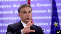 Hungarian Prime Minister Victor Orban speaks during a media conference at EU Headquarters in Brussels on Wednesday, Nov. 17, 2010. (AP Photo/Virginia Mayo)