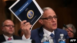 FILE - Fred Hochberg, Chairman and President of the Export-Import Bank of the United States, holds up a copy of the bank's Default Rate Report as he testifies before a congressional committee June 4, 2015 on Capitol Hill in Washington, D.C.