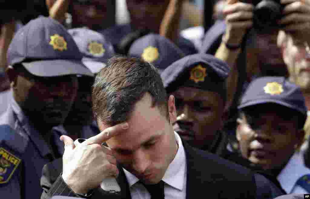 Oscar Pistorius leaves the high court in Pretoria, South Africa, Oct. 13, 2014.