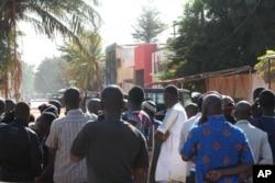 Onlookers gather near the Radisson Blu hotel after gunmen stormed the building in Bamako, Mali, Nov. 20, 2015.