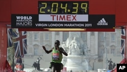 Emmanuel Mutai of Kenya crosses the finish line to win the men's London marathon, April 17, 2011
