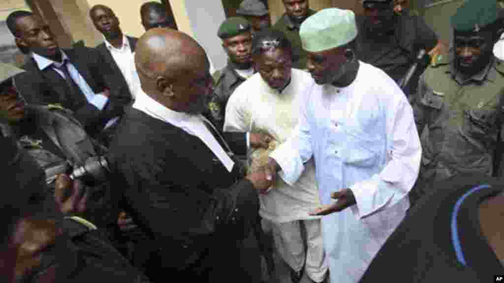 In this 2011 photo, Nigeria's former Chief security officer, Maj. Hamza Al-Mustapha, shake hands with one of his lawyers before his trial at the federal high court in Lagos.