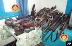 FILE - This photo taken Monday, Match 7, 2016 and provided by the Tunisian Defense Minister on Tuesday, March 8, 2016 shows weapons seized by Tunisian forces from militants in the city of Ben Guerdane, southern Tunisia. (Tunisian Defense Ministry via AP)