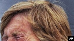 Diana Nyad cries as she speaks to reporters and fans after arriving back in Key West, Florida August 9, 2011