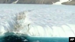 A massive ice island has broken off the coast of Greenland.