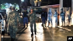 Maldives defense soldiers patrol on the main street of Male, Maldives, Feb. 5, 2018.