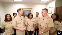A screen grab from the U.S. Navy's Facebook Live event on Tuesday, July 10, 2018. Chief of Naval Operations Adm. John Richardson is joined by servicewomen for the announcement on policy changes regarding hairstyles. (Courtesy of U.S. Navy via AP)