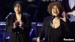 Mavis Staples (R) and Yvonne Staples (L) perform after they and the rest of the Staples Singers accepted their induction into the Rock & Roll Hall of Fame at the 14th Annual Rock and Roll Hall of Fame Induction Ceremony at New York's Waldorf Astoria Hotel, March 15, 1999.