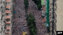 香港市民2019年6月9日举行空前规模的游行,抗议港府修订逃犯条例。