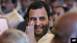 Congress party leader Rahul Gandhi greets attends the swearing-in ceremony for the new ministers in New Delhi, India, October 28, 2012.