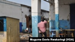 A man looks at what remains of a house in Malakal, South Sudan.