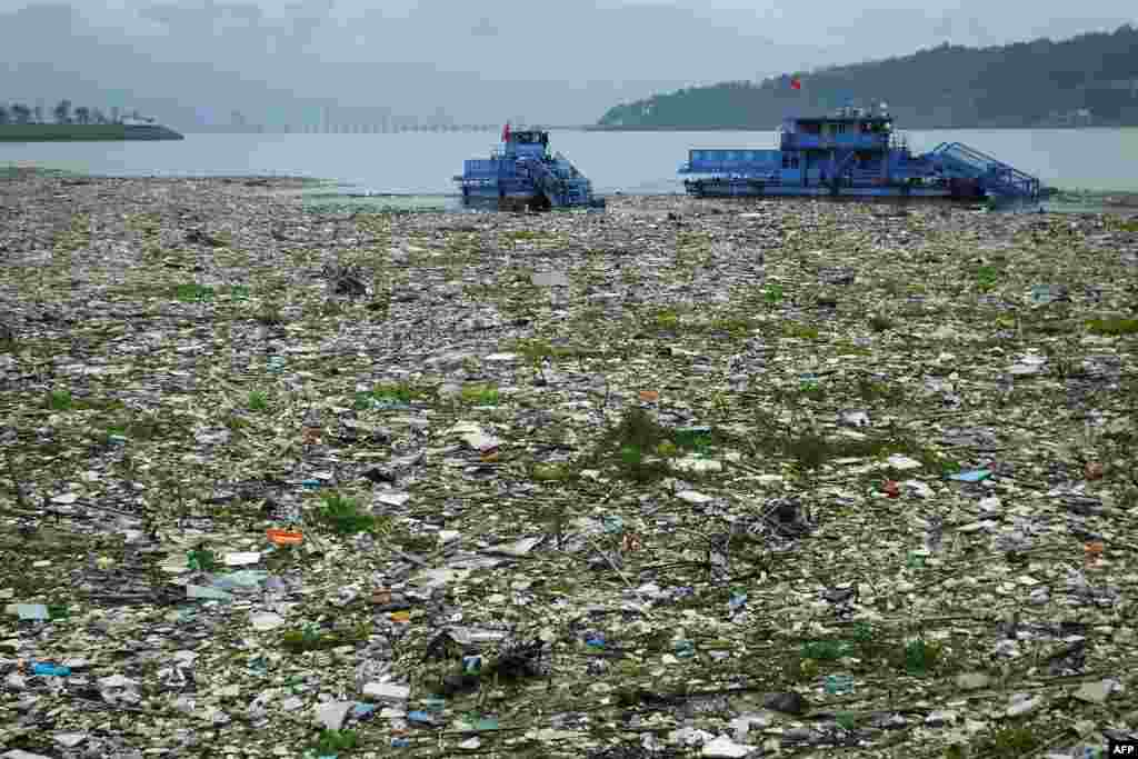 Workers in boats remove garbage from the Yangtze River in Yichang, in central China's Hubei province, China.