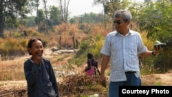 Im Chaem, a former Khmer Rouge regional commander, in a picture with Youk Chhang, executive director of the Documentation Center of Cambodia, in Anlong Veng, Cambodia, February 13, 2012. (Courtesy of Documentation of Cambodia)