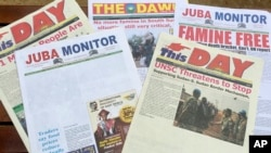This photo taken June 22, 2017 shows South Sudanese newspaper front pages, including two with news stories removed by the printer on the instructions of the government in Juba.