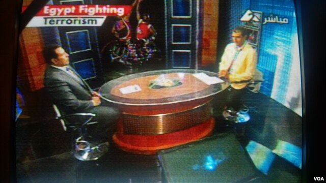 "Egyptian television displays the ""Egypt Fighting Terrorism"" banner during a sports program, August 20, 2013."