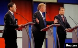 Republican U.S. presidential candidate Donald Trump gestures towards rivals Marco Rubio (L) and Ted Cruz (R) at the U.S. Republican presidential candidates debate in Detroit, Michigan, March 3, 2016.