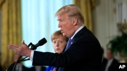 President Donald Trump speaks during a news conference with German Chancellor Angela Merkel in the East Room of the White House in Washington, April 27, 2018.