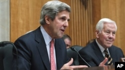 Senate Foreign Relations Committee Chairman Senator Kerry, left, with committee's ranking Republican, Senator Lugar, Washington, Feb. 2011.