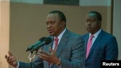 Le président Uhuru Kenyatta et son ministre de l'Intérieur Fred Matiangi à Nairobi, Kenya, le 14 août 2017.