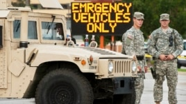 Missouri National Guard soldiers stand by at a police command post in Ferguson, Missouri, Aug. 19, 2014.