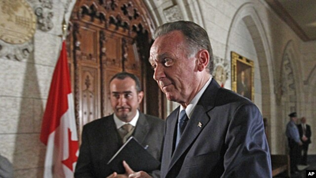 Canada's Environment Minister Peter Kent leaves after announcing that Canada will formally withdraw from the Kyoto protocol on climate change, on Parliament Hill in Ottawa, December 12, 2011.