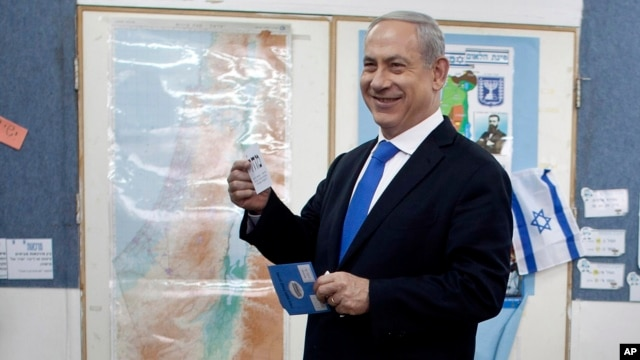 Israeli Prime Minister Benjamin Netanyahu casts his ballot at a polling station in Jerusalem, January 22, 2013.