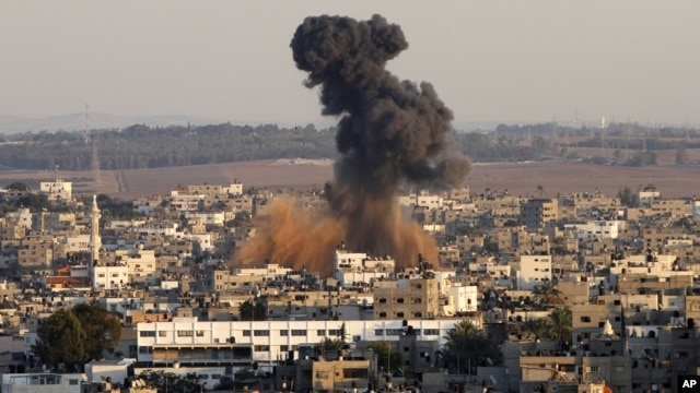 Smoke rises following an Israeli attack on Gaza City, Thursday, Nov. 15, 2012.