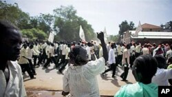 A southern Sudanese woman chants with pro-independence activists as they march through the southern capital of Juba on 9 Sep 2010. Hundreds of citizens took part in the rally, which aims to bolster support for an independence referendum that will determi
