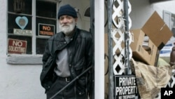 Charles O'Bryan, on probation for hoarding-related health code violations, stands outside his Cincinnati home in 2008.