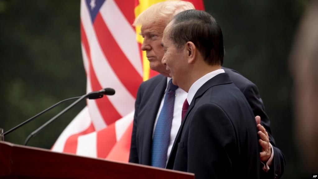 Tổng thống Trump và Chủ tịch Quang trong cuộc họp báo chung hôm 12/11.