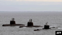 FILE - This photo released by Telam shows three submarines upon arrival to Mar del Plata's Navy Base, June 13, 2014.