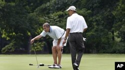 President Barack Obama and House Speaker John Boehner, left, are on the first hole of their game of golf at Andrews Air Force Base, Maryland, June 18, 2011
