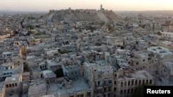 FILE - A general view taken with a drone shows Aleppo's historic citadel, controlled by forces loyal to Syria's President Bashar al-Assad, as seen from a rebel-held area of Aleppo, Syria. The Syrian regime and Russia are continuing their 'starve, get bombed or surrender' strategy in eastern Aleppo, says U.S. Ambassador to the U.N. Samantha Power.