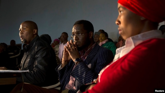 Mandla Mandela (L), grandson of former South African President Nelson Mandela, talks to journalists during a news conference in Mvezo in the Eastern Cape of South Africa, July 4, 2013.
