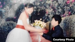 A wedding photo of Ly thi Minh, then 14 years old, and Pay Long Phe, the Chinese man who bought her from human traffickers.