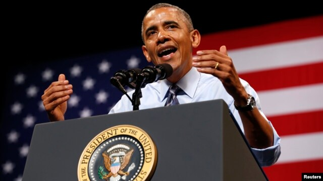 U.S. President Barack Obama speaks about the economy during a visit to Austin, Texas, July 10, 2014.