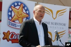 FILE - CKE Restaurants CEO Andy Puzder speaks at a news conference in Austin, Texas, Aug. 6, 2014.
