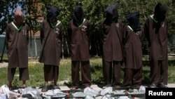 FILE - Insurgents suspected of belonging to the Haqqani network are presented to the media at the National Directorate of Security (NDS) headquarters in Kabul, Afghanistan, May 30, 2013.