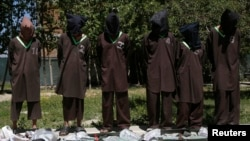 File - Insurgents suspected of being from the Haqqani network are presented to the media at the National Directorate of Security (NDS) headquarters in Kabul, May 2013.