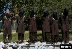 FILE - Insurgents suspected of being from the Haqqani network are presented to the media at the National Directorate of Security (NDS) headquarters in Kabul, May 30, 2013.