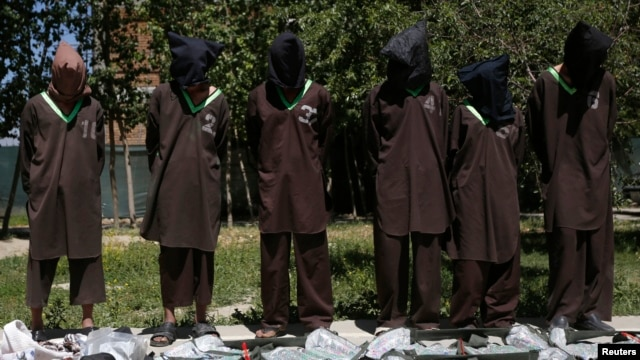 FILE - Insurgents suspected of being from the Haqqani network are presented to the media at the National Directorate of Security (NDS) headquarters in Kabul May 30, 2013.