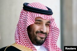 Saudi Arabia's Deputy Crown Prince Mohammed bin Salman reacts upon his arrival at the Elysee Palace in Paris, June 24, 2015.