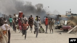 FILE - South Sudanese civilians flee fighting in an United Nations base in the northeastern town of Malakal on February 18, 2016, where gunmen opened fire on civilians sheltering inside killing 30 people and injuring 123 others.